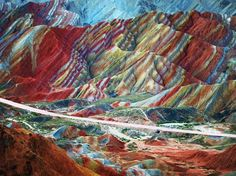 These striped, technicolor mountains are Mother Nature's answer to Photoshop. Red sandstone and mineral deposits have been building up in China's Danxia Landform Geological Park for more than 20 million years, causing the surreal layered effect.