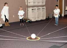 Star Wars Party game. The kids try to lift up the ball without if falling off the middle circle.