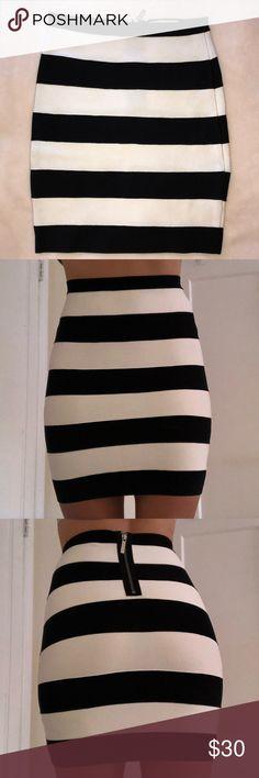 Michael by Michael Kors Bandage Skirt size 0 Michael by Michael Kors black and white striped bandage skirt. Silver zipper on the back. Size 0. 90% rayon, 9% nylon, 1% spandex MICHAEL Michael Kors Skirts Mini