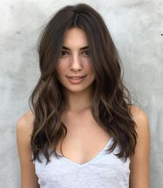 Long Wavy Centre-Parted Hairstyle