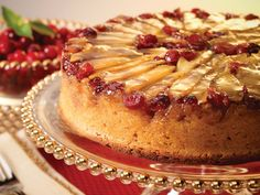 Upside-down Apple Cranberry Cake - Fresh cranberries and slices of apples top this beautiful upside down cake! The caramel sauce on top helps keep the cake moist.