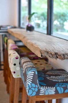rustic reclaimed wooden bar + seats in different fabrics