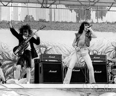 Angus Young & Bon Scott / AC/DC by Larry Hulst