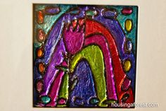 Using tin foil, sharpies and a glue gun, make some art that looks like Latin American hammered tin...