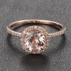 Hint hint brandon....i want a morganite ring that has diamonds and rose gold rose to wear on my wedding day. <3 gold morganite circle