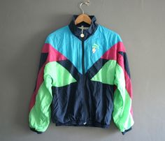 Neon 90s puma shell suit jacket available now on Ebay...