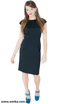 """""""Myreel"""", constructed with stretchy ponte fabric, a gorgeous black knee length dress."""