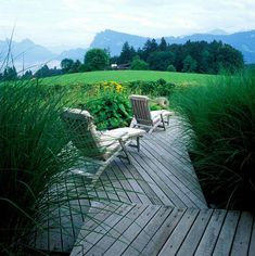 Switzerland Oasis on Lake Lucerne by Anthony Paul Landscape Design Bog Garden, Garden Paving, Outdoor Spaces, Outdoor Chairs, Outdoor Decor, Miscanthus Sinensis Gracillimus, Landscape Design, Garden Design, Deck Stairs
