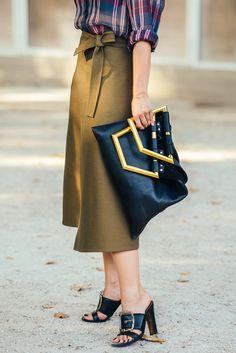 Plaid top, olive skirt, black buckled sandals, black leather bag with gold hardware