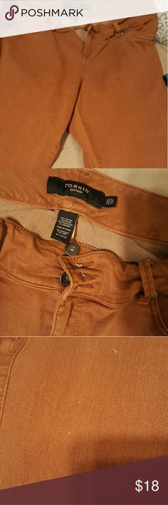 Torrid rust colored jeggings These have only been worn a couple times but there is some slight snagging as shown in picture 3. These are from some tall buckle boots when I crossed my legs. These are a short inseam. Priced accordingly. torrid Jeans Skinny