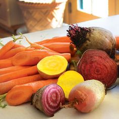 Learn how to cultivate and prepare beets and carrots, and get information on popular varieties of these root vegetables, from 'Chioggia' and 'Bull's Blood' beets to 'Mokum' carrots. Root Vegetables, Fruits And Veggies, Gardening Vegetables, Vegetable Garden, Veggie Recipes, Real Food Recipes, Veggie Meals, Chicken Garden, Gardening Zones