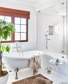 Lauren Conrad's bathroom with honey comb tile floors, a freestanding tub, and a shower