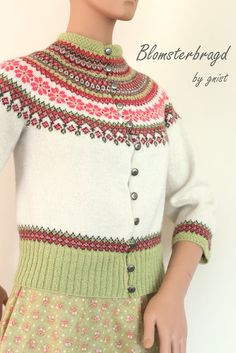 I don't care for the width and length of the cardigan, but find the yoke pattern and colours beautiful.