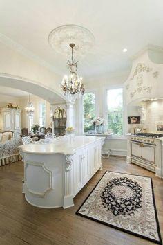 ~ White kitchen, chandelier, unique island