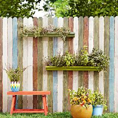 All fences are functional -- even the simplest ones are good at delineating the neighbor's yard from your own -- but this one takes practicality to new heights. Not only are the boards brushed with green, blue, and gray exterior wood stain for a lively striped look, but the fence also holds aloft a couple of gutter gardens. That's right: Inexpensive vinyl gutters -- the ideal shallow plant container -- were cut into 3-foot sections (folks at the hardware store can do it for you) and then…