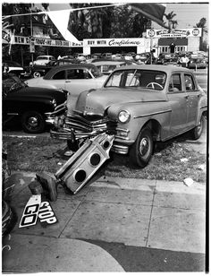 A Plymouth collided into a semaphore traffic signal in an accident at the corner of 23rd and Figueroa in Los Angeles (1952)