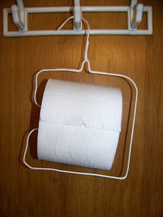 Clothes Hanger Toilet Paper Holder for Camping via- Making Cooley Stuff