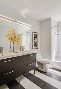 Contemporary Full Bathroom with specialty tile floors, Limestone counters, High ceiling, Flush, European Cabinets