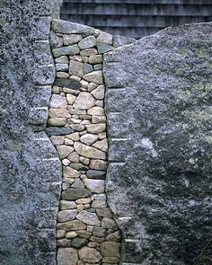 intricate inlayed pebble chinking between large rocks (Stone Master, Lew French)