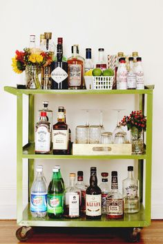 Dazzle party guests with a glamorous bar cart! Get inspiration to create a showstopping display. See the full post on Style Spotters: http://www.bhg.com/blogs/better-homes-and-gardens-style-blog/2013/08/29/organizing-this-serving-stations/?socsrc=bhgpin083113barcart