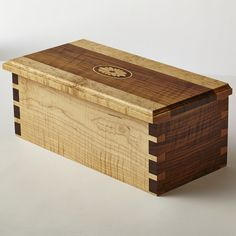 Decorative Boxes: Curly walnut and curly maple box with dovetail joints and inlaid wood medallion. Woodworking Box, Custom Woodworking, Woodworking Projects, Woodworking Machinery, Quick Diy Jewelry, Cremation Boxes, Dovetail Box, Jewelry Box Plans, Woodworking Inspiration