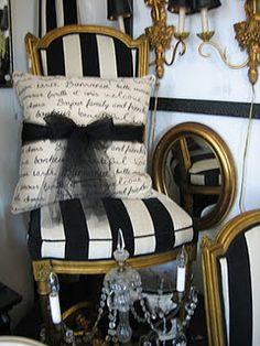 Black and white striped chair enhanced with a white and black cushion wrapped in a black bow. Simple and stunning.