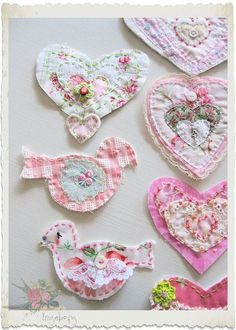 need to make some...maybe for a pillow!?! - cute shaped cottage inspired fabrics, layered with vintage scraps, embroidery, tiny buttons and beads, embroidered flowers, hearts, birds