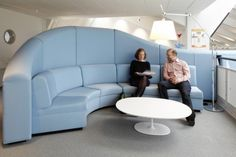 Blue meeting area self screening sofa