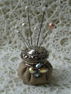 Adorable!  Made from old salt shakers!  What a great way to display my antique hat pins!!!