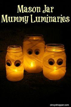 Dollar Store DIY Mason Jar Mummy Luminaries! Inexpensive Halloween decor made with items found at the Dollar Store. So cute!
