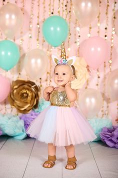The cutest Unicorn Tutu Dress for the Unicorn Birthday Girl. Gold sequin top romper with a pastel rainbow tutu. The perfect Unicorn costume for a birthday photo session and Halloween. Shop for the best Unicorn Outfits for girls at www.bellethreads.com #unicornparty #birthdayparty #unicorndress #unicornbirthdayparty #unicorntutu