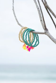 Tassel Bracelet Stacker Set. S A L T | W A T E R The cure for anything is salt water: sweat, tears or the sea. Isak Dinesen On trend neon tassels add something special to your outfit, and all items are designed to layer and stack to add extra oomph. Each stacking set comes with one each of Neon Coral, Neon Pink & Neon Yellow. Wooden Beads 2cm Nylon Tassel 20cm Length (Elasticised for comfort) #RubyAndLilli