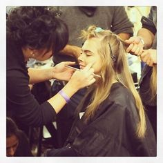 Even in the makeup chair @caradelevingne has a smile on her face :) #nyfw #fashion