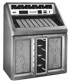 """1987, Rowe AMI's Model R-91 Sapphire 90 and Golden 90: """"No horizontal surfaces! Avoids problem of spilled drinks."""" [Jukebox Collector]"""