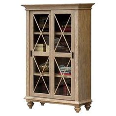"""Showcase travel books and captivating curios in this handsome bookcase. Crafted of hackberry wood, this rustic design features 2 sliding glass doors and 3 adjustable shelves.        Product: Bookcase    Construction Material: Hackberry hardwood solid, ash veneer and glass    Color: Weathered natural  Features:   Two sliding framed glass doors enclose three adjustable shelves  Tip restraining hardware          Dimensions: 66"""" H x 42"""" W x 18"""" D"""