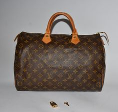 SOLD:  Authentic Louis Vuitton Monogram canvas Speedy 35 with the original lock and key.  Authentic very gently used excellent designer brand bags at lower price, please visit my store!!  Grantaboutique.com