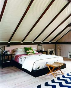 Contemporary Small Attic Bedroom Ideas With Sloping Ceiling As Well White Blue Striped Rug On Hardwood Flooring Also Lamps Table The Bedside Cozy Small Attic Bedroom Design and Decorating Ideas sloping ceilings. cool attic rooms. attic bedroom conversion.