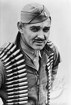 "Clark Gable (1901-1960) Major US Army Air Corps 1942-44 WW II. ""Although beyond draft age, Clark Gable enlisted as a private. Assigned to OCS he excelled and received a commission. He flew five combat mission as an observer/gunner in a B-17earning a Distinguished Flying Cross and an Air Medal. On his fourth mission, a 20mm shell cut the heel from his boot. His discharge was signed by Captain Ronald Reagan."""