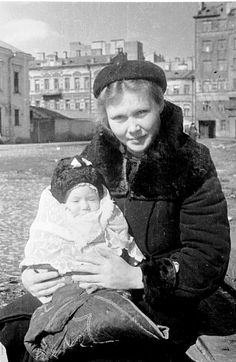 A resident of besieged Leningrad with a child, Spring 1943.