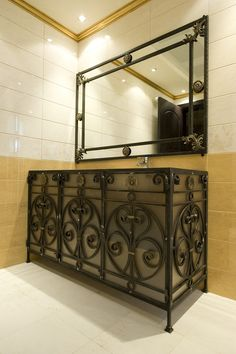 A Spanish romantic-style bathroom with a vanity made of an antique stone basin and custom wrought iron details. Description from pinterest.com. I searched for this on bing.com/images