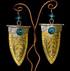 Carl Stanley: teaches jewelry in Santa Barbara goldslipearrings.gif