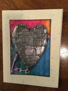 Heart note card. Heart made with foil tape. Then painted with black acrylic paint