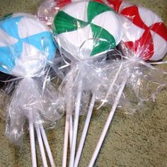 Outdoor Christmas Decorations:  dowel rods painted white.  White styrofoam plates glued together.  With a craft knife, cut edges off.  Paint candy design.  Wrap with cellophane.