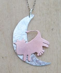 Copper cow jumps over the sterling silver moon. Pendant version available from Jewellery By Silvana