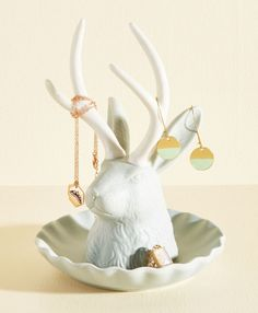 A regal jewelry stand that lets you organize your baubles on its antlers.   32 Christmas Decorations You'll Want To Keep Up All Year