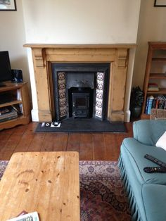 Wood burning stove in victorian fireplace