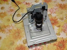 Microscope manager  Device that manages the USB camera microscope: Make easy focus with DVD stepper motor and light the object with different colors and intens. By Borislav4.