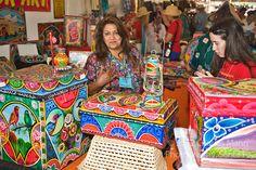 Anjun Rana from Pakistan in her booth of Tribal Truck Art at the Santa Fe International Folk Art Market, held each year in July in Santa Fe, New Mexico.anjrana@yahoo.com    www.tribaltruckart