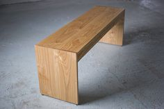 square bench for the entry way area.  maybe then he will stop throwing his stuff on the kitchen table.