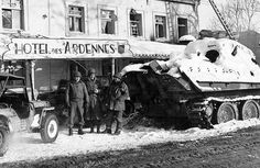 American soldiers beside a German Panther tank, which was destroyed by an Sherman tank, in Ligneuville. #WW2